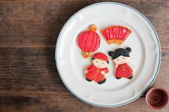 Top view of homemade gingerbread as Chinese boy and girl dolls i Royalty Free Stock Image