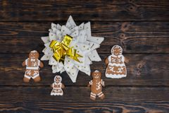 Top view of homemade gingerbread Christmas tree with cute ginger. Bread family on wooden desk. Mockup for seasonal offers and holiday post card Stock Image