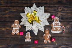 Top view of homemade gingerbread Christmas tree with cute ginger. Bread family with gifts on wooden desk. Mockup for seasonal offers and holiday post card Royalty Free Stock Images