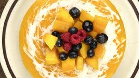 Top view of homemade mango cheesecake.