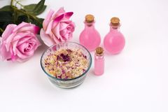 Homemade scrub with sea solt,aroma oils and rose petals. Top view homemade scrub with sea salt,aroma oils and rose petals Stock Image
