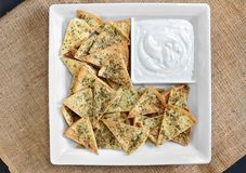 Top view of homemade spicy pita chips and dip. Stock Photography