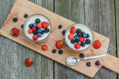 Top view on homemade vanilla pudding with raspberries and blackb Royalty Free Stock Photo