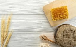 Top view of Honey comb and glass honey jar on wooden background royalty free stock photos
