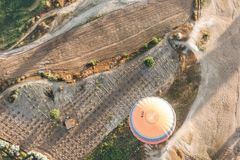 Top view of hot air balloon flying above majestic landscape. In cappadocia, turkey stock image