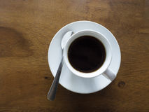 Top view of hot black coffee cup. On wood table Royalty Free Stock Images