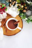 Top view of Hot Chocolate with Cinnamon Stick. On wooden board decoartion in winter concept with copyspace stock image