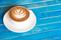 Top view hot chocolate in cup on blue wooden table. Royalty Free Stock Images