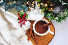Top view of Hot Chocolate Cup on Wooden Board. Top view of hot chcolate with cinnamon stick on wooden board with space for text royalty free stock images
