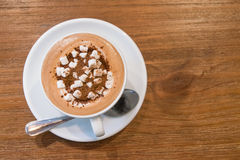 Top view of hot chocolate with marshmallows on wooden table Stock Image