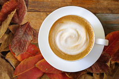 Top view of hot coffee cappuccino cup with milk foam on wood tab Stock Images