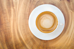 Top view of hot coffee cappuccino cup with milk foam on wood tab Royalty Free Stock Photography