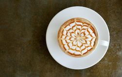 Top view of hot coffee cappuccino latte art top view on concrete table Stock Image