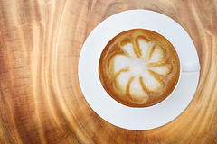 Top view of hot coffee cappuccino latte cup with saucer on wood Stock Images