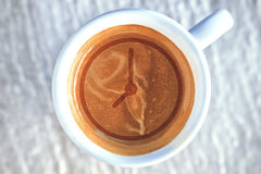 Top view of hot coffee cappuccino spiral foam, creative idea for time to coffee, product photography Royalty Free Stock Photos