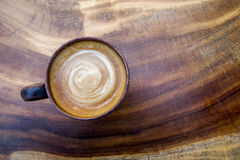 Top view of hot coffee latte cappuccino cup on wood texture back Royalty Free Stock Photography