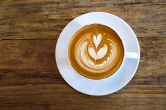 Top view of hot coffee latte cup with rosetta latte art milk foa Royalty Free Stock Photos