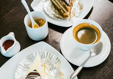 Top view of hot coffee, sugar, cakes and desserts on wooden tabl Stock Image