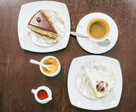 Top view of hot coffee, sugar, cakes and desserts on wooden tabl Stock Images