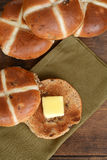 Top view hot cross bun with butter on green napkin Stock Image