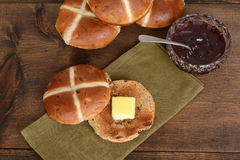 Top view hot cross bun with butter and jam Royalty Free Stock Image