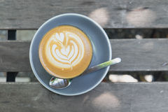 Top view of hot latte coffee. On brown wood table Royalty Free Stock Photo