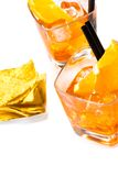 Top of view of hot tacos chips in front of two glasses of spritz aperitif aperol cocktail with orange slices and ice cubes Stock Photography