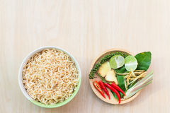Top view after hot water bow. L of instant noodles and Spices, vegetables on wooden Stock Photo