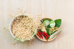 Top view after hot water bowl. Of instant noodles and Spices, vegetables on wooden Royalty Free Stock Image