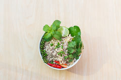 Top view after hot water bowl. Of instant noodles and Spices, vegetables on wooden Stock Photo