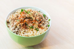 Top view after hot water bowl. Of instant noodles and Spices, vegetables on wooden Stock Image