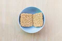 Top view Before hot water bowl. Of instant noodles on wooden table Royalty Free Stock Image