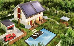 Top view of the house with a garage and solar panels on the roof. Top view of the multi-family house with a garage and solar panels on the roof stock photography