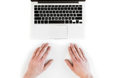 Top view of human hands and laptop computer isolated on white Stock Photography