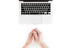 Top view of human hands and laptop computer isolated on white Royalty Free Stock Image