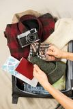 Packing vintage stylish hipster clothes and accessories for a hiking holiday in north Europe royalty free stock photos