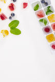 Top view of ice cubes with berries and fruits. Isolated on white Stock Photography