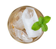 Top view of ice cubes in a glass and honey sink to the bottom de stock photography