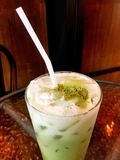 Top view `Ice Green Tea` on the table glass Royalty Free Stock Photography