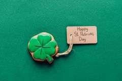 Top view of icing cookie in shape of shamrock on green, st patricks day concept stock photography