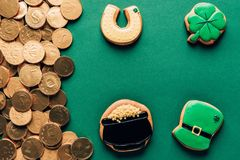 Top view of icing cookies and golden coins, st patricks day concept royalty free stock images
