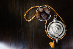 Top view of iftar fruit - dates and islamic rosary. Royalty Free Stock Photo