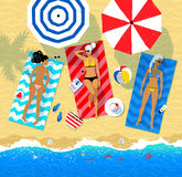 Top view illustration of three young women lying on beach Stock Image