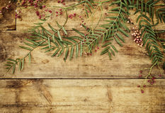 Top view image of autumn leaves over wooden textured background Royalty Free Stock Image