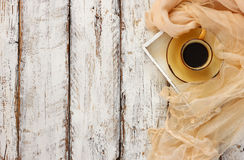 Top view image of chiffon fashion scarf with to cup of coffee on a wooden table Royalty Free Stock Photography