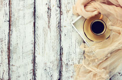 Top view image of chiffon fashion scarf with to cup of coffee on a wooden table. retro filtered photo Royalty Free Stock Image