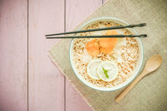 Top view image of Chinese noodle in bowl on top of rustic wood Royalty Free Stock Photos