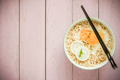 Top view image of Chinese noodle in bowl on top of rustic wood Royalty Free Stock Photo