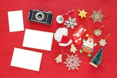 Top view image of christmas festive decorations next to old camera and empty photo frames. For photography and scrapbook montage Stock Images