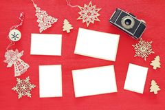 Top view image of christmas festive decorations next to old camera and empty photo frames. For photography and scrapbook montage Royalty Free Stock Image